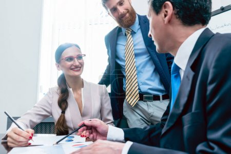 Business team having motivating discussion in office