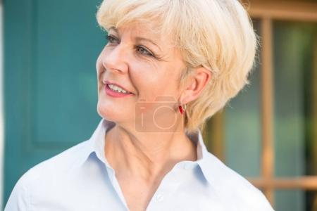 Close-up portrait of a cheerful senior woman with good health an
