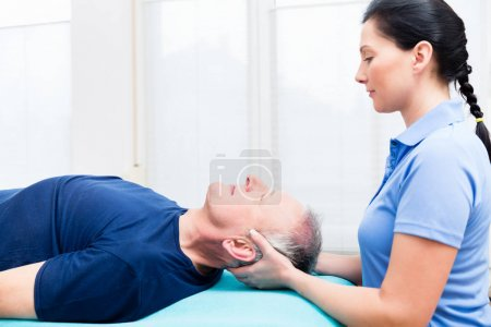 man visiting physiotherapist