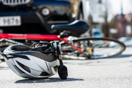 bicycling helmet on asphalt