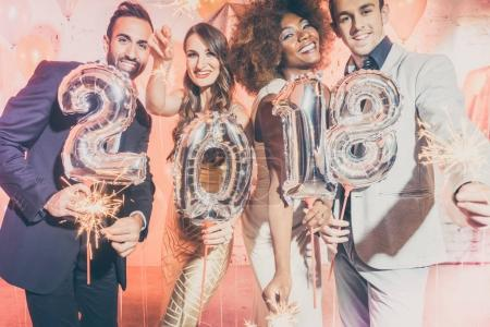 Party people women and men celebrating new years eve 2018
