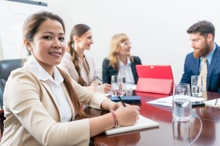 Portrait of a confident Asian business woman during a decision-m