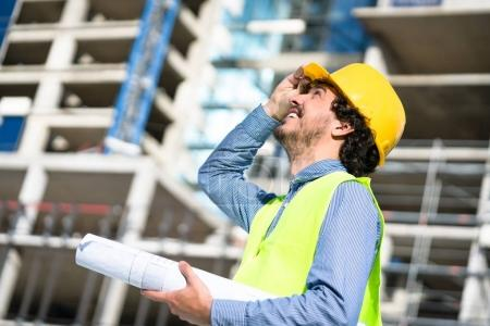 Construction engineer studying floor plan