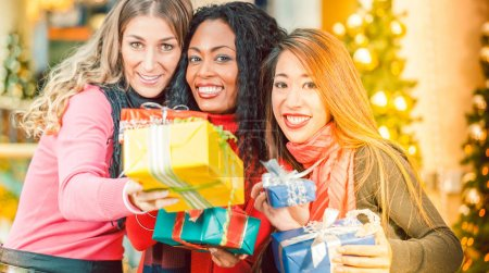 three women with Christmas presents