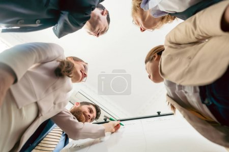Low-angle view of an international team working together during