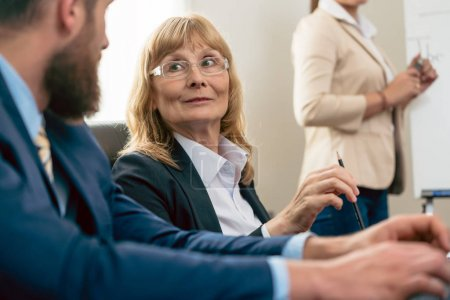 Portrait of a middle-aged woman with an impressive career during