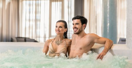 couple sitting in jacuzzi