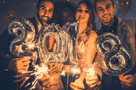 Men and women celebrating new year 2018