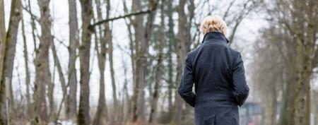 Photo for Unhappy woman having walk in winter park - Royalty Free Image