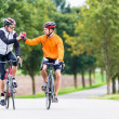Racing cyclists after sport and fitness workout gi...
