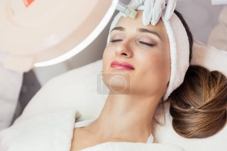 Close-up of the face of a woman relaxing during non-surgical fac