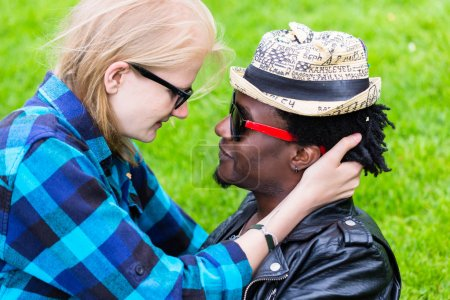 Caucasian woman and African man in loving embrace