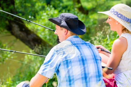 Couple, woman and man, with fishing rods sport angling