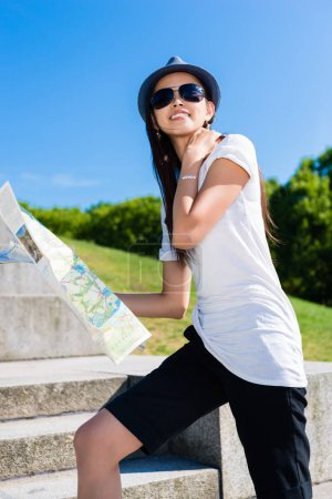Happy young Asian tourist climbing stairs