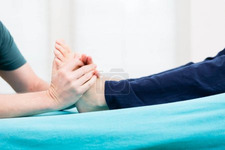 Patient having foot massage at physio