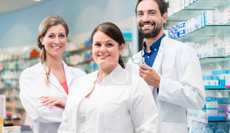 Team of apothecaries in pharmacy