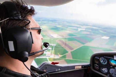 Sport Pilot flying his plane