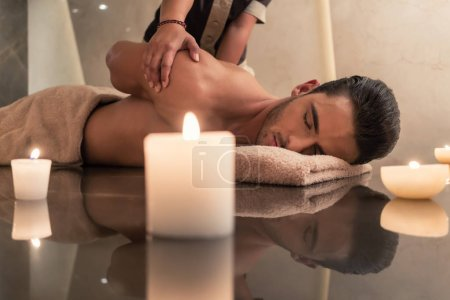 Young man enjoying the healing benefits of traditional Thai massage