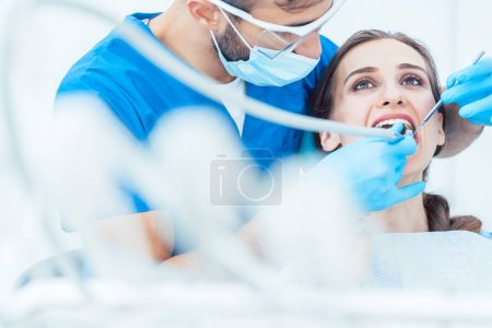 Young woman during painless oral treatment in a modern dental office