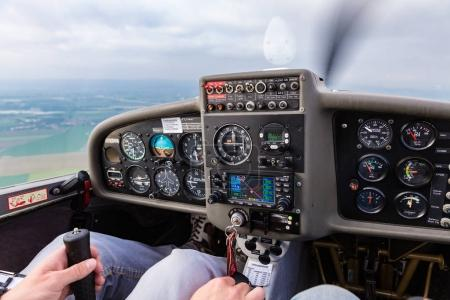 Pilot flying a private sport airplane using the steering stick