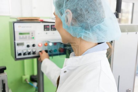Experienced manufacturing operator controlling industrial equipment
