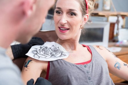 Portrait of a woman getting a new tattoo in a professional studio