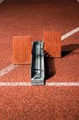 Starrting blocks at cindertrack of athletics stadium