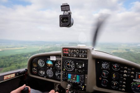 Pilot flying a private sport airplane