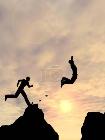 Photo for Men jumping over cliff with sunset on background - Royalty Free Image