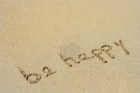 handwritten be happy in sand