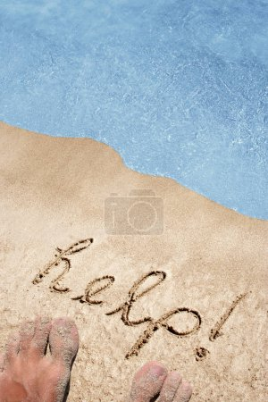 sand on a beach background with feet