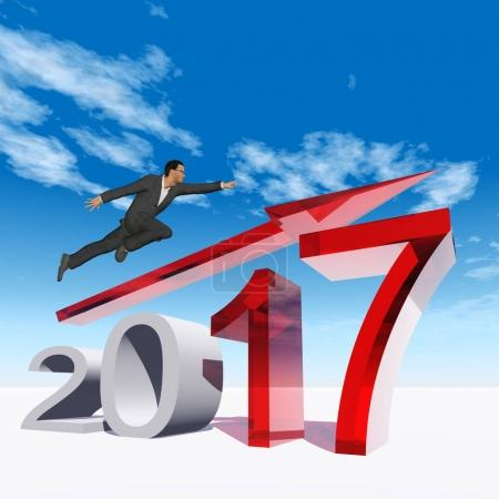 businessman flying  over 2017 year symbol