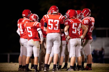 Photo for High School american Football Team during match - Royalty Free Image