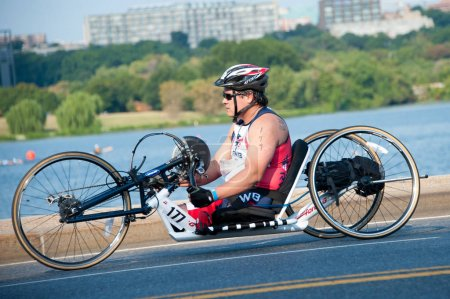 Hand Cyclist Competing in Triathlon