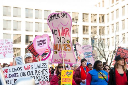 Photo for Demonstrators rally in support of womens rights, including equality in the work place, at the U.S. Department of Labor in Washington DC on March 8, 2017, International Womens Day - Royalty Free Image