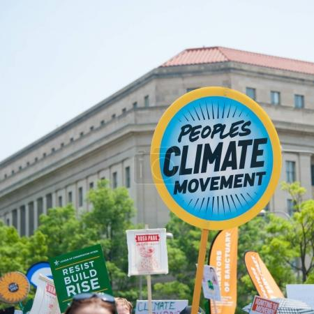 Protesters hold sign at Peoples Climate March