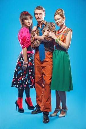 Photo for Young people wearing colorful old-fashion clothes in pinup style. Also they can represent members of a youth counterculture Stilyagi existed from the late 1940s until the early 1960s in the Soviet Union - Royalty Free Image