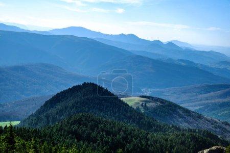 Mountains peak through fog, Bratocea pass, Ciucas mountains, Brasov county, Romania, 1720m