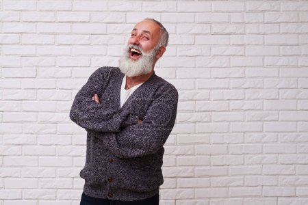 Attractive beard male laughing and standing confidently against