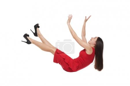 Female in red dress falling down