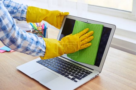 Female in gloves cleaning with mop display of laptop
