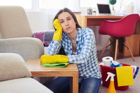 Tired woman after cleaning of table
