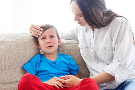 Young Caucasian mom soothing crying son