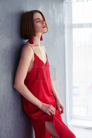 Sexy female posing in red dress