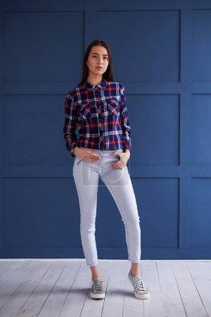 Beautiful slim girl posing at studio