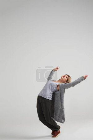 Beautiful modern dancer working out at studio