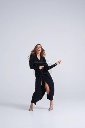 Fashionable woman in fluttering long dress