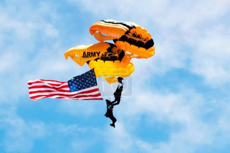 Two US Army Paratroopers carrying the American Flag