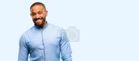 African american man with beard confident and happy with a big natural smile looking side isolated over blue background