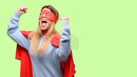 Young super woman happy and excited celebrating victory expressing big success, power, energy and positive emotions. Celebrates new job joyful